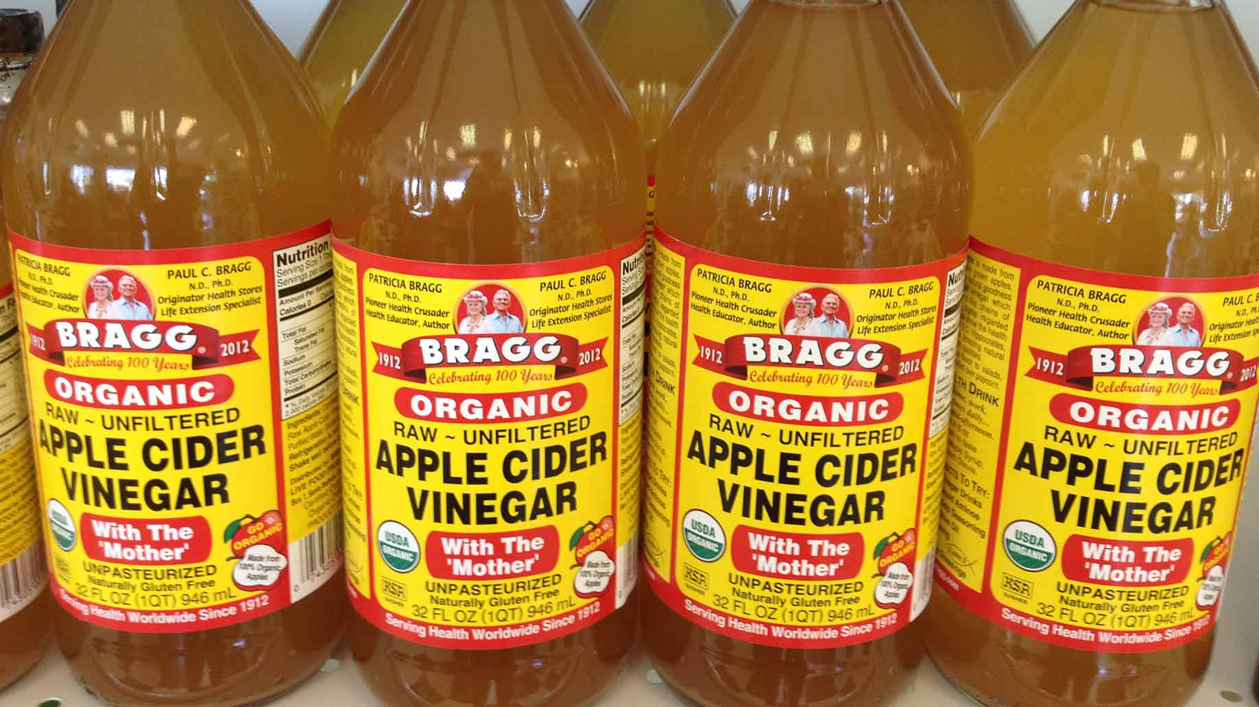 "bragg organic raw unfiltered apple cider vinegar in glass jar with the ""mother"""