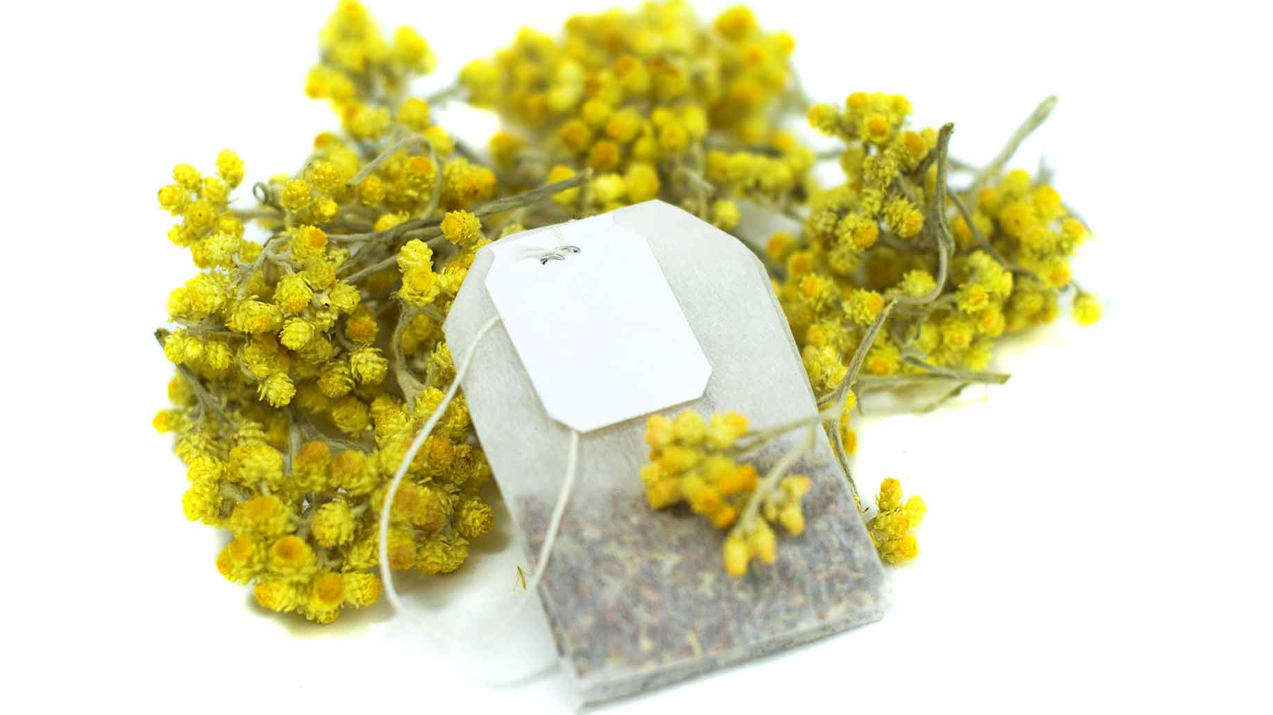chamomile tea with flowers and teabag