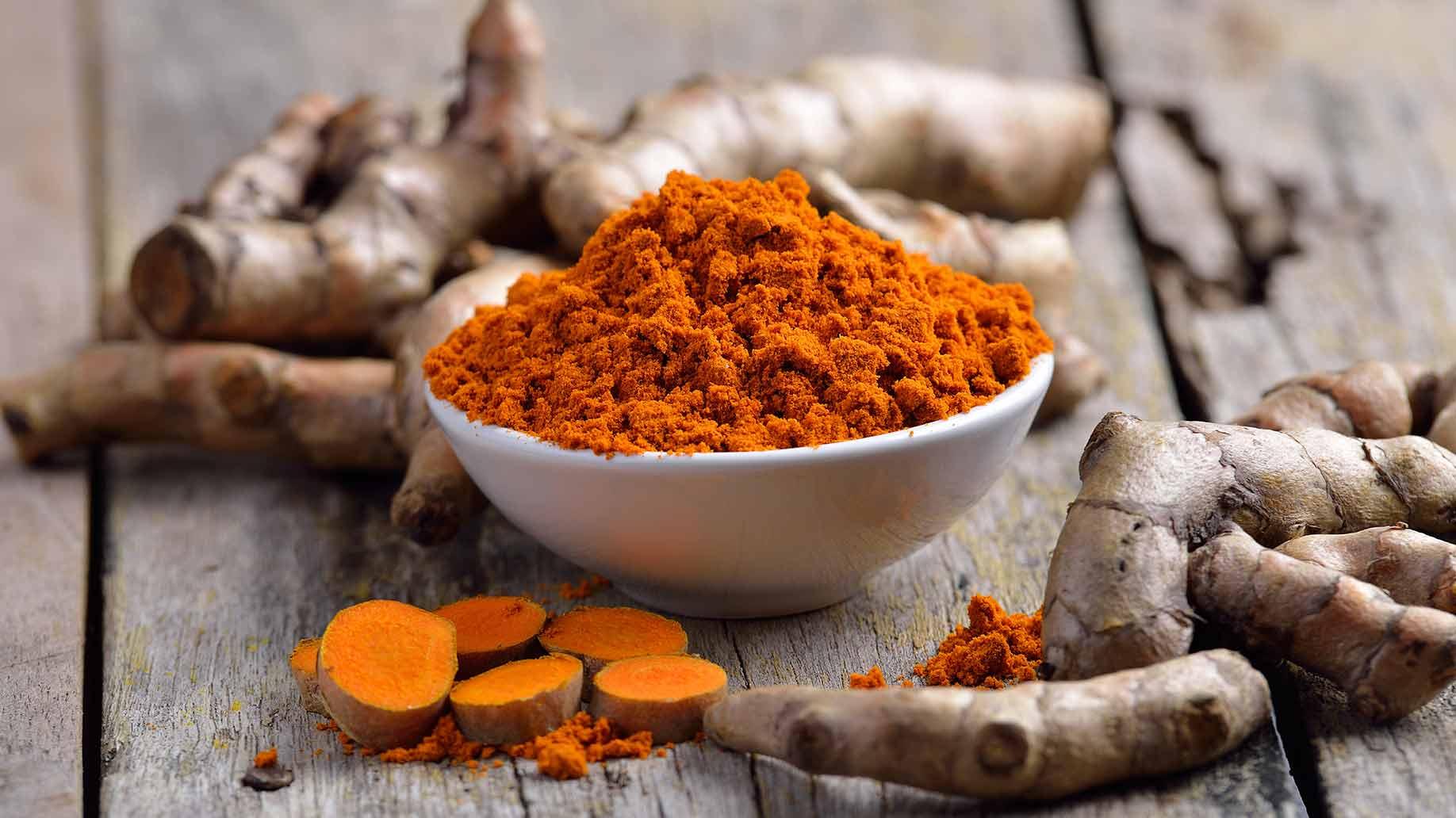 turmeric herb fresh roots orange powder