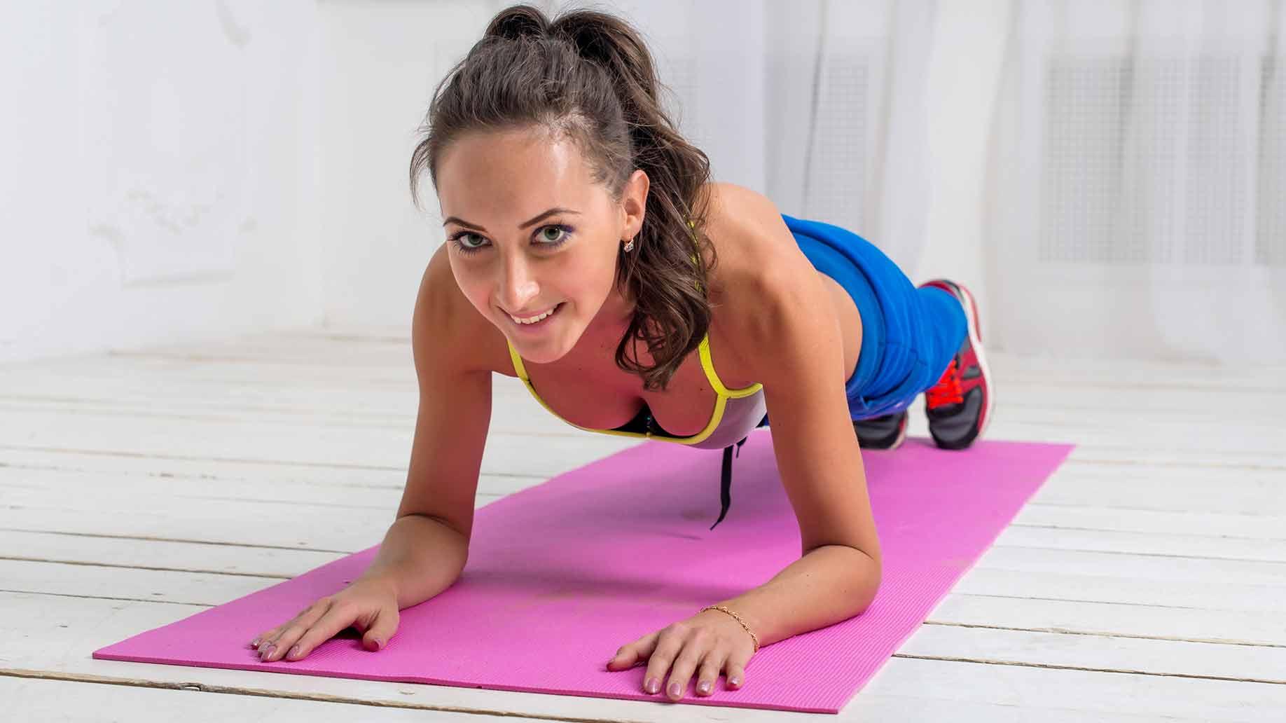 yoga exercise aerobics girl with pink mat