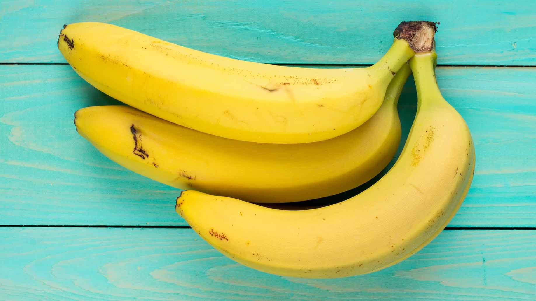 ripe yellow bananas batch teal background