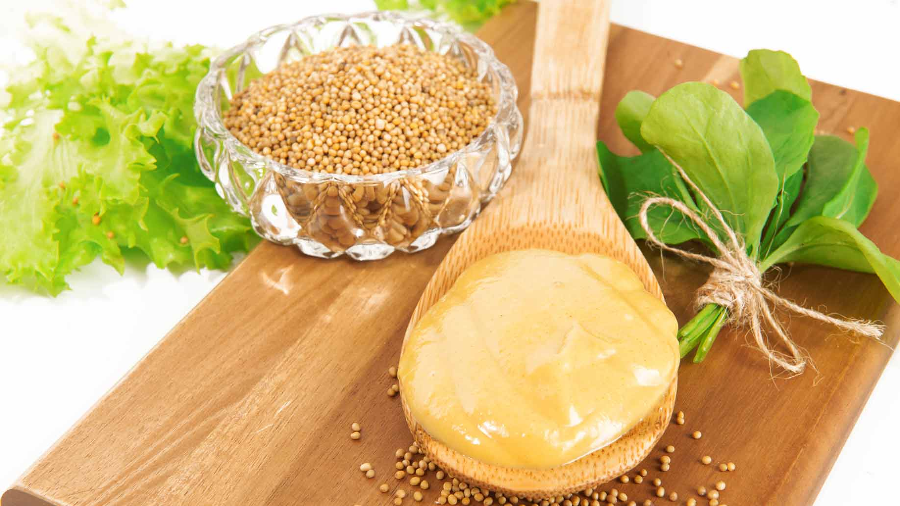 yellow mustard spoonful small seeds with green leaves
