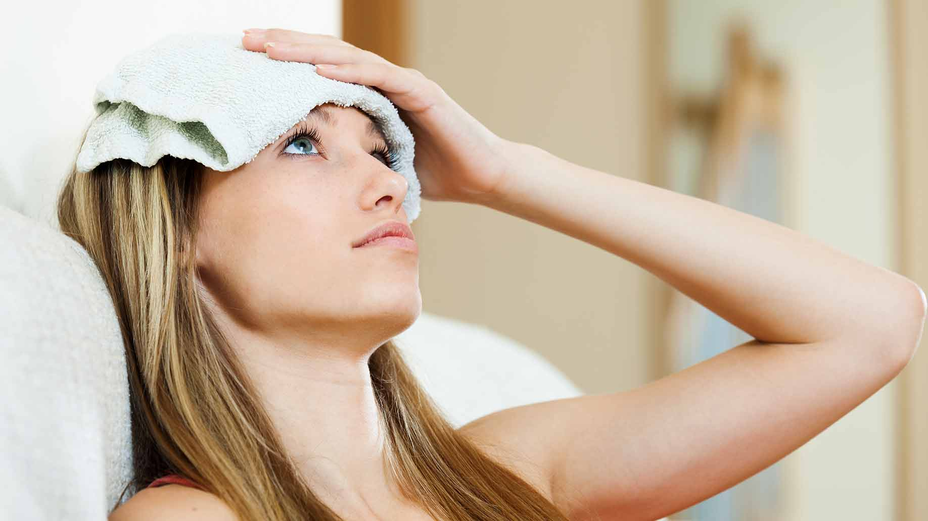 warm hot cold compress wet towel forehead headaches migraines natural remedies